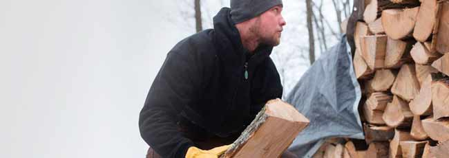 arborist-in-the-winter-stacking-wood