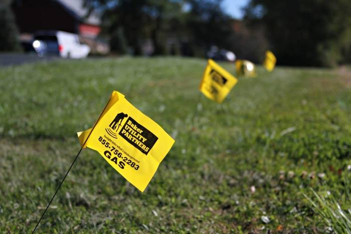 yellow flag marking underground utilities